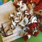 "Photo by Carolyn Hall: the ""Field Guide"" under a cascade of sliced mushrooms and red bell peppers"